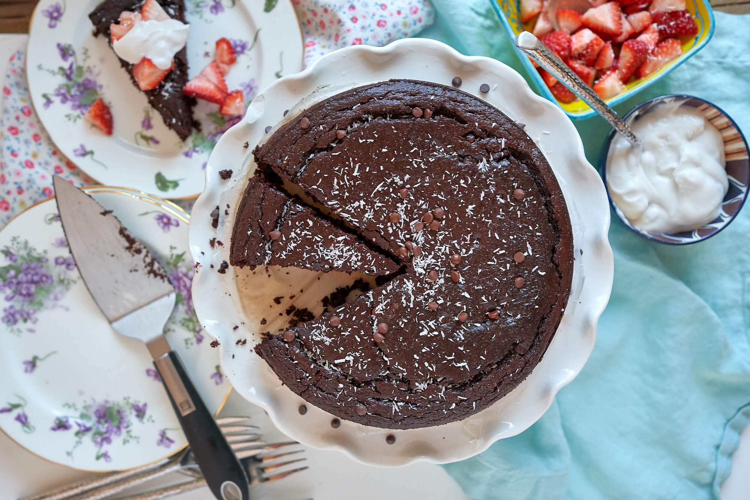 flourless chocolate cake with strawberries and coconut cream